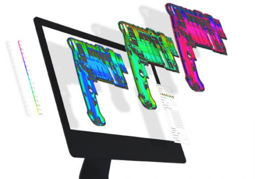Computer screen with coloured images exploding from it