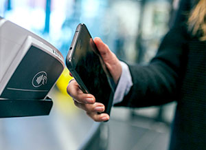 Man using contactless on a mobile phone